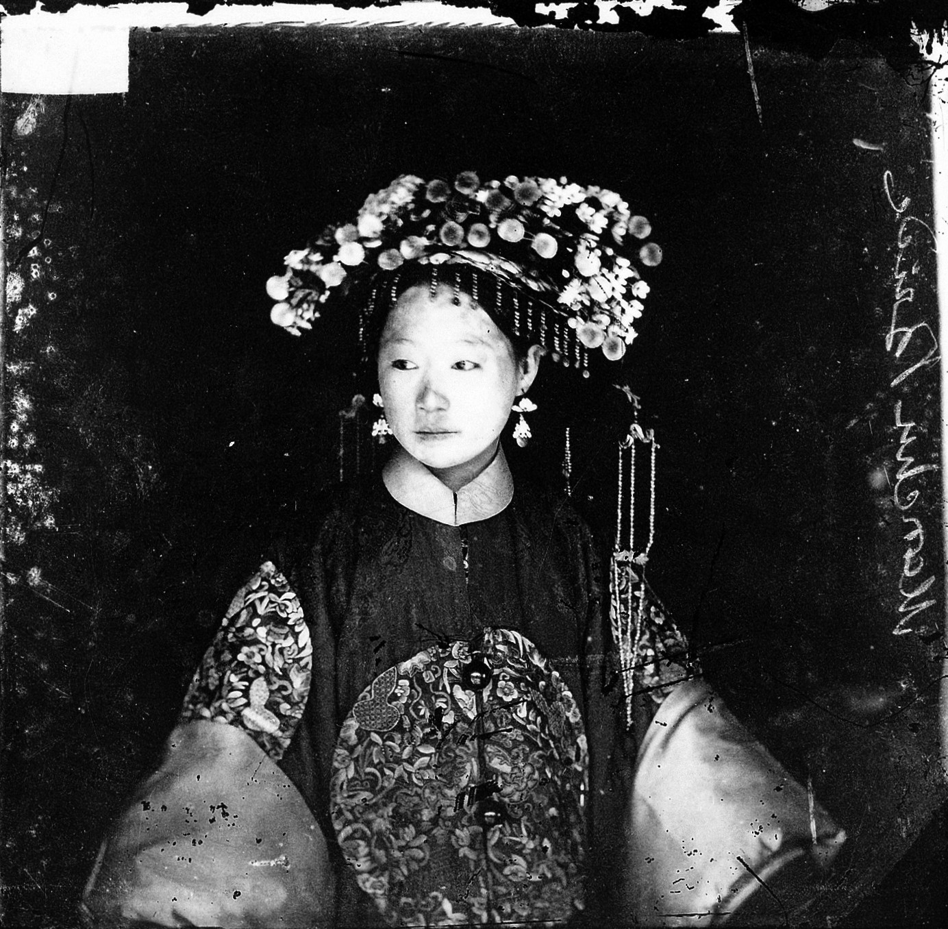 L0018855 Manchu bride, Peking, Penchilie province, China Credit: Wellcome Library, London. Wellcome Images images@wellcome.ac.uk http://wellcomeimages.org Manchu bride in her wedding clothes, Peking, Penchilie province, China Photograph 1871 By: J. ThomsonPublished: [1871] Copyrighted work available under Creative Commons Attribution only licence CC BY 4.0 http://creativecommons.org/licenses/by/4.0/