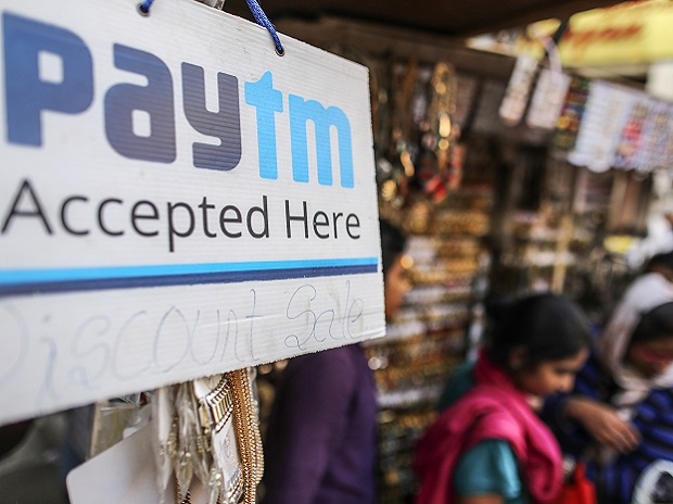 A sign for PayTM online payment method, operated by One97 Communications Ltd., is displayed at a street stall selling accessories in Bengaluru, India, on Saturday, Feb. 4, 2017. A relative laggard in digital transactions, India has more recently seen 50 percent year-on-year growth, according to a study by Google and Boston Consulting Group. The pace may accelerate with demonetization giving digital wallets like Paytm, MobiKwik and Freecharge an extra push. Photographer: Dhiraj Singh/Bloomberg